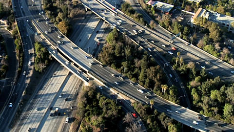 Traffic along freeway overpass aerial Footage