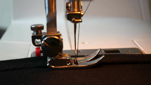 Sewing machine working part with dark cloth Image