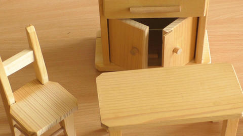 Wooden doll furniture: table, chairs and buffet. Miniature wooden toy furniture  Footage
