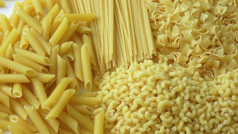 Set of raw dry pasta. Variety of types of Italian pasta Footage