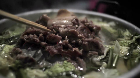 Pork Korean Barbecue on a hot pan with smoke slow motion Live Action