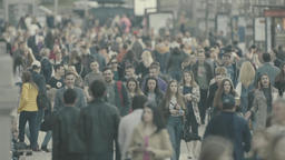 Many people walk down the street Footage