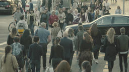 The crowd crosses the road on the pedestrian crossing. Slow Motion Footage