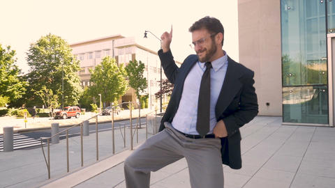 Handsome male business executive with a beard silly victory dancing his success Footage