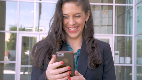 A happy sexy successful millennial businesswoman smiling while reading e-mail or Footage