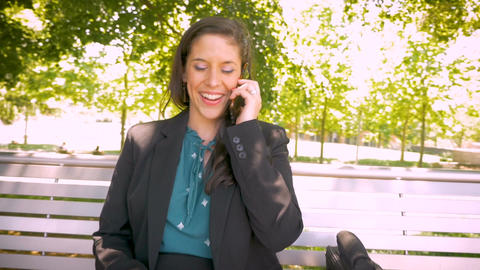 Happy smiling attractive millennial woman working with laptop and talking on Footage