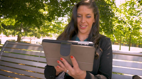Happy smiling woman in her 30s wearing business clothing holding touchpad Footage