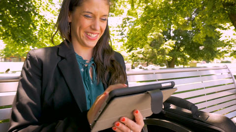 Happy smiling businesswoman working on digital tablet mobile app technology Footage