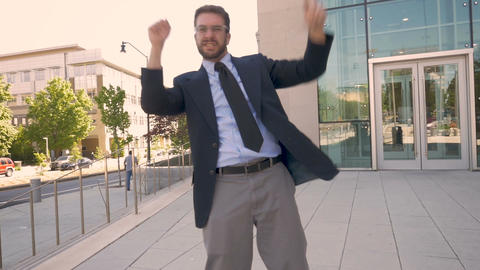 Handsome millennial businessman celebrating and silly goofy dancing directly Footage