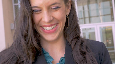 Beautiful happy smiling businesswoman looking at her mobile phone close up shot Footage