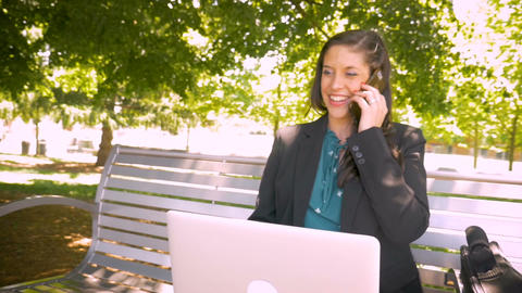 Beautiful powerful female business executive happily working with laptop and Footage