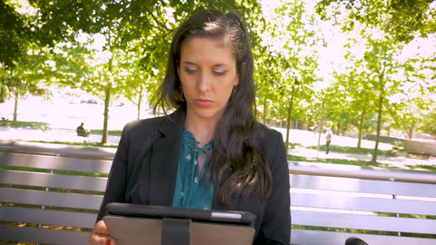 Attractive woman wearing business attire working on digital tablet mobile app Footage