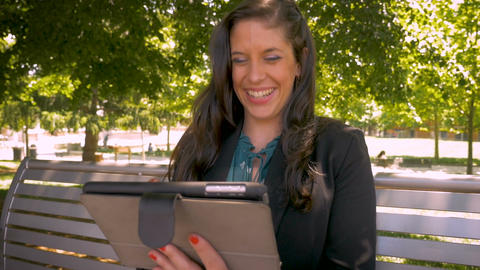 Candid real moment of an attractive millennial businesswoman laughing while Footage
