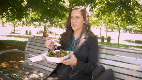 Young pretty millennial 30s woman eating healthy salad with leafy greens and Footage