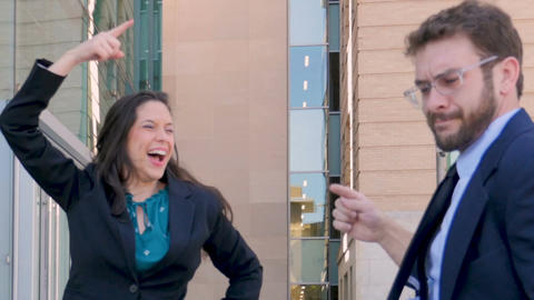 A handsome male and attractive female business partners dancing and celebrating Footage