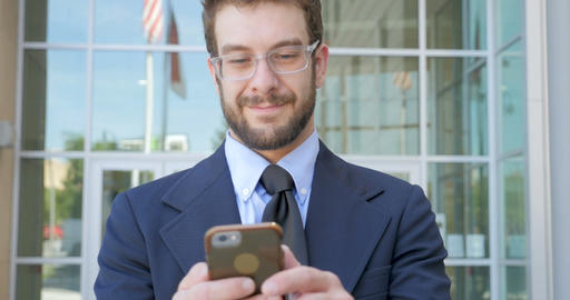 Happy attractive smiling millennial 30s businessman writing a text message email Footage
