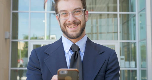 Portrait of handsome millennial man in a business jacket... Stock Video Footage