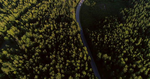 Cars on island road Cinema 4k aerial view of cars driving on a asphalt road in t Footage
