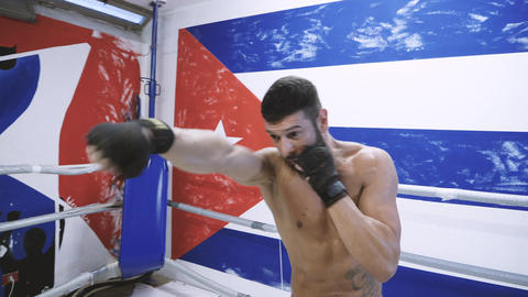 Young male boxer doing shadow boxing exercise Footage