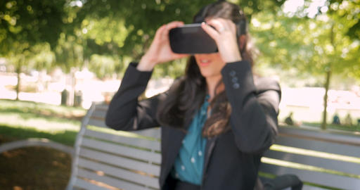 Attractive millennial businesswoman leaves her virtual reality world removing Footage