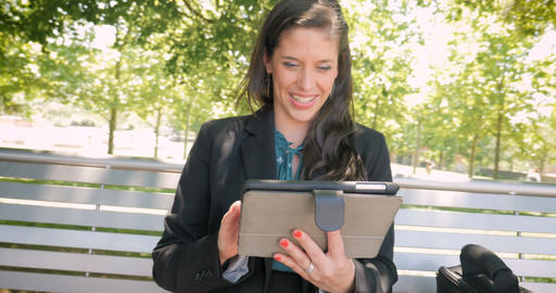 Happy smiling laughing attractive woman wearing business attire working on Footage