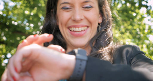 Low angle close up of a smiling happy business woman using smart watch Footage