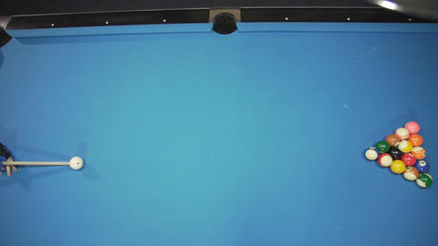 An opening spread on a pool table Live Action