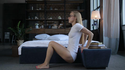 Lovely fit woman doing morning exercise in bedroom Footage