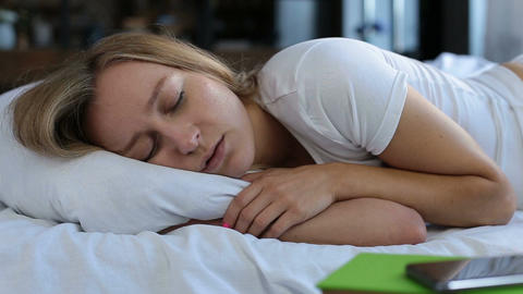 Pretty young woman snoring in bed Footage