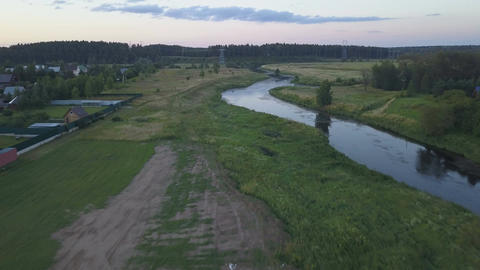 Drone flying along the river ビデオ