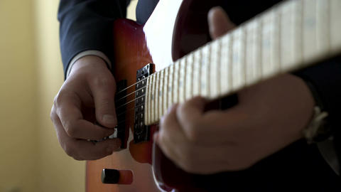 Playing electric guitar Live Action