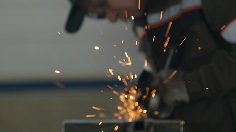 Slow Motion Oil Enterprise Worker Welds Steel Structure Footage