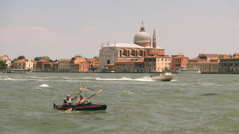 Boats and kayakers sail in slow motion in Venice, Italy Footage