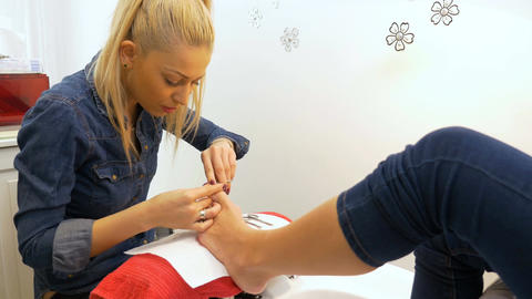 Beautician performs professional pedicure at beauty salon Footage