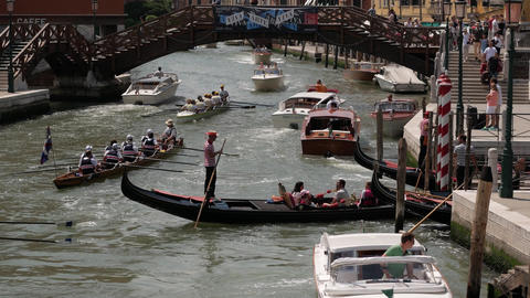 Gondola taxi boat with rowing canoes in Venice Footage