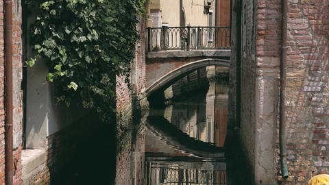 Bridge view reflecting in the water, Venice, Italy Footage