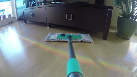 Wooden floor cleaning with modern broom with wet mop at home. 4K Footage