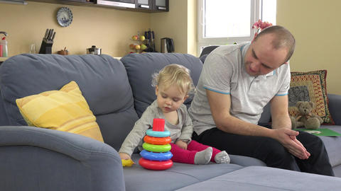 lovely girl and loving father play colorful pyramid... Stock Video Footage