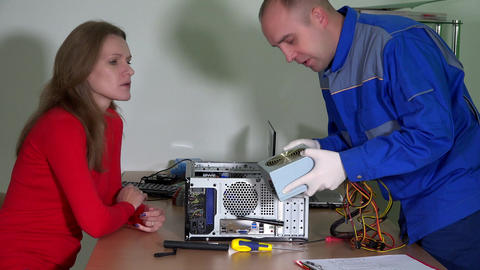 Skilled computer repairer man consult client woman about changed parts Footage