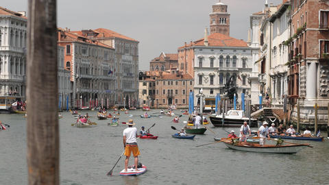Lonely man rowing at kayaking competition. Venice, Italy Footage