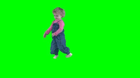 Crazy little child girl romp dance move isolated on green Footage