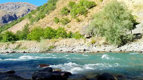 Quick and cool river Ugam in mountain Tashkent Image