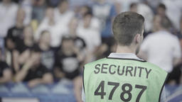 The steward guy watches the fans at the stadium. Security Footage