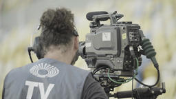 Cameraman with camera. TV Footage