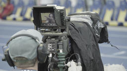 Cameraman with a TV camera in the stadium Footage