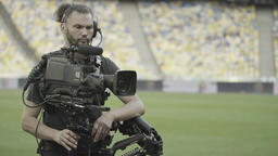 TV. Steadicam cameraman working on a TV camera in the stadium Footage
