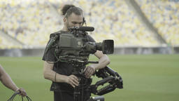 The cameraman with the TV camera steadicam during shooting. The media. TV Footage