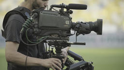 Steadicam cameraman working on a TV camera in the stadium Footage