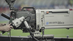 TV cameraman with a camera during the broadcast at the stadium Footage