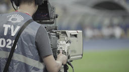 Cameraman with a camera during the broadcast at the stadium TV Footage